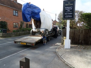 Looking slightly ungainly on a flat bed trailer...